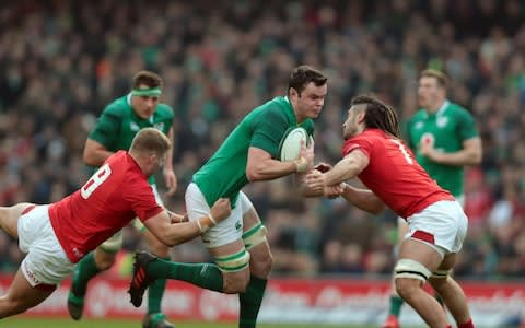 James Ryan (Ireland) drives in to contact with Ross Moriarty (Wales) and Josh Navidi (Wales) - Credit: Getty Images