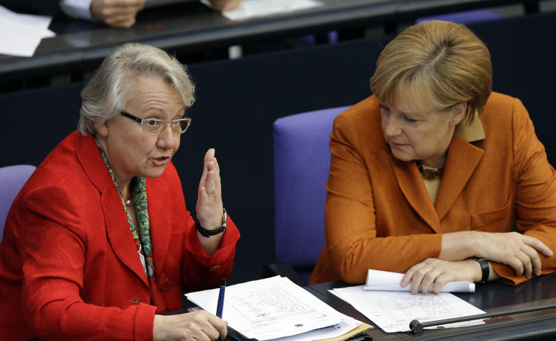 FILE - The Oct. 18, 2012 file photo shows German Science Minister Annette Schavan, left, as she talks to German Chancellor Angela Merkel, right, during a meeting of the German Federal Parliament, Bundestag, in Berlin. Germany's education minister has been stripped of her doctorate following an investigation into allegations that she plagiarized parts of her thesis, which explored the formation of conscience. German news agency dpa reports that a committee of academics at Duesseldorf's Heinrich Heine University took the decision late Tuesday, Feb. 5, 2013 after considering the case against Annette Schavan. Schavan denies the allegations, first raised by an anonymous blogger last year, that she failed to properly cite passages of her 1980 thesis in philosophy. (AP Photo/Michael Sohn, file)