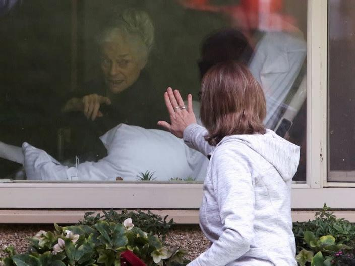 FILE PHOTO: Lori Spencer visits her mom Judie Shape, 81, who Spencer says has tested positive for coronavirus, at Life Care Center of Kirkland