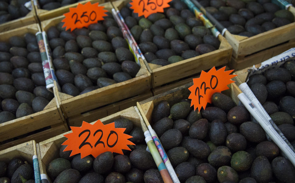 Avocados are displayed for sale in a large market in Mexico City, Tuesday, Aug. 9, 2016. A crate of avocados as those pictured cost around $12. Americans' love for avocados and rising prices for the highly exportable fruit are fueling the deforestation of central Mexico's pine forests as farmers rapidly expand their orchards to feed demand. (AP Photo/Nick Wagner)