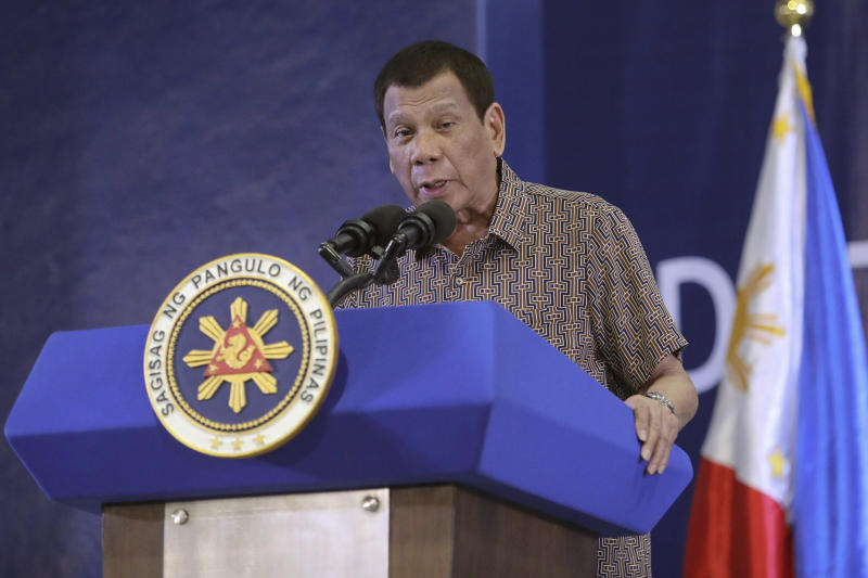 In this Jan. 23, 2020, photo provided by the Malacanang Presidential Photographers Division, Philippine President Rodrigo Duterte delivers his speech at the San Isidro Central School during the distribution of benefits to former rebels in Leyte province, southern Philippines. Duterte has renewed a threat to terminate an accord that allows American forces to train in the country unless Washington restored a visa of a political ally linked to human rights violations. (Karl Norman Alonzo/Malacanang Presidential Photographers Division via AP)
