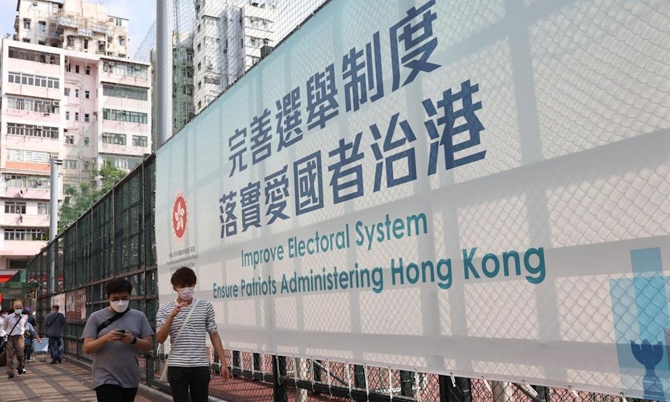 A government banner touts the drastic overhaul of Hong Kong's electoral system endorsed in Beijing on Tuesday. Photo: K. Y. Cheng