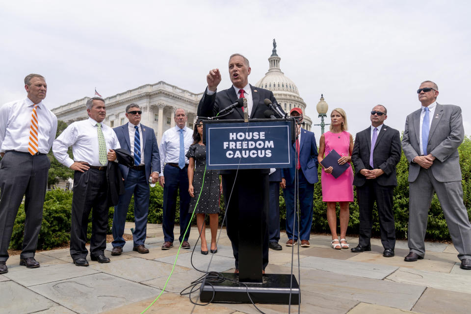 Rep. Andy Biggs, R-Ariz., Chairman of the House Freedom Caucus, center, accompanied by other members of the caucus, speaks at a news conference on Capitol Hill in Washington, Thursday, July 29, 2021, to complain about Speaker of the House Nancy Pelosi, D-Calif. and masking policies. (AP Photo/Andrew Harnik)