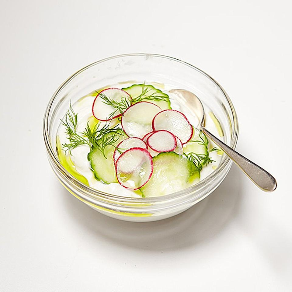 """<p>Yogurt is delicious as a tart and creamy base for vegetables, says Cheryl Sternman Rule, the author of <a rel=""""nofollow"""" href=""""http://www.amazon.com/Yogurt-Culture-Global-Creamiest-Healthiest/dp/0544252322/ref=sr_1_1?s=books&ie=UTF8&qid=1456759097&sr=1-1&keywords=yogurt+culture""""><em>Yogurt Culture</em></a>. Mix a pinch of sea salt into six ounces of plain yogurt and top with thinly sliced radishes and cucumbers. Drizzle with olive oil, sprinkle with chopped dill, and finish with a pinch more of sea salt. (Did you know that Greek yogurt is among <a rel=""""nofollow"""" href=""""https://www.shape.com/healthy-eating/diet-tips/best-and-worst-foods-flat-abs"""">The Best Foods for Flat Abs</a>?)</p>"""
