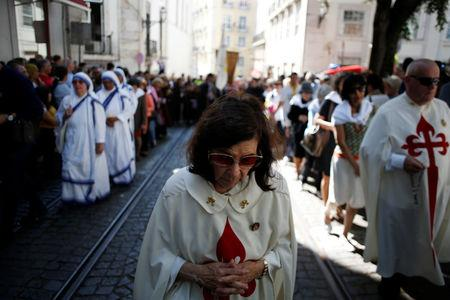 People take part in the Saint Anthony procession in Lisbon, Portugal, June 13, 2018. Picture taken June 13, 2018.   REUTERS/Pedro Nunes