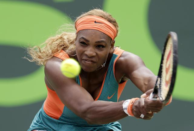 Serena Williams, of the United States, returns to Li Na, of China, during the women's final at the Sony Open Tennis tournament in Key Biscayne, Fla., Saturday, March 29, 2014. (AP Photo/Alan Diaz)