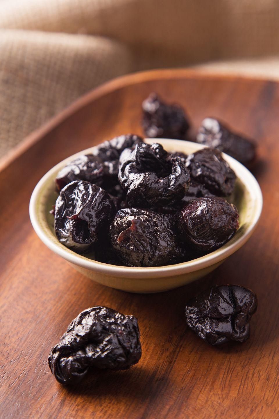 """<p>Prunes, which are dried plums, are packed with polyphenols — plant chemicals that have been shown to boost bone density by stimulating your bone-building cells, according to research published in <em><a href=""""https://www.ncbi.nlm.nih.gov/pubmed/26902092"""" rel=""""nofollow noopener"""" target=""""_blank"""" data-ylk=""""slk:Osteoporosis International"""" class=""""link rapid-noclick-resp"""">Osteoporosis International</a></em>.</p><p><strong>Recipe to try:</strong> <a href=""""https://www.womansday.com/food-recipes/food-drinks/recipes/a11652/slow-cooker-chicken-marbella-recipe-122895/"""" rel=""""nofollow noopener"""" target=""""_blank"""" data-ylk=""""slk:Slow Cooker Chicken Marbella"""" class=""""link rapid-noclick-resp"""">Slow Cooker Chicken Marbella</a></p>"""