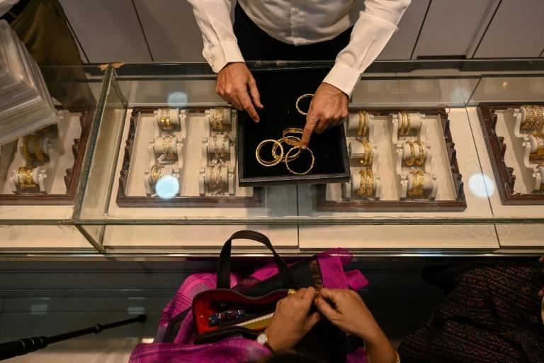 Desperate families and firms have been forced to put up gold jewellery as collateral to secure short-term loans, with banks lending 4.71 trillion rupees ($64 billion) in the first eight months of the year, a 74 percent rise year on year (AFP/Punit PARANJPE)