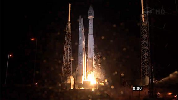An Atlas 5 rocket carrying NASA's TDRS-K next-generation satellite launches from a pad at Cape Canaveral Air Force Station in Florida at 8:48 p.m. ET on Jan. 30, 2013.