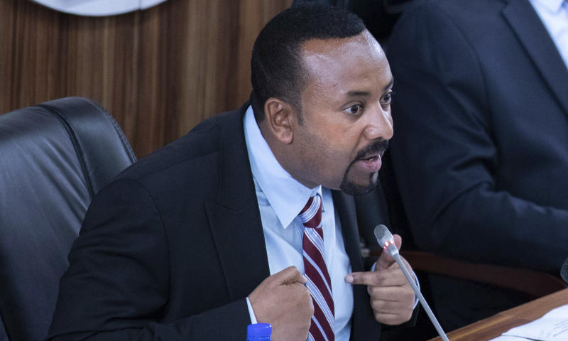Ethiopian Prime Minister Abiy Ahmed addressing members of parliament on the current situation of the country inside the Parliament buildings, in Addis Ababa, Ethiopia, Tuesday Oct. 22, 2019. Ethiopia's Nobel Peace Prize-winning prime minister is warning that if there's a need to go to war over a dam project disputed with Egypt his country could ready millions of people, but he says only negotiation can resolve the deadlock. (AP photo Mulugeta Ayene)