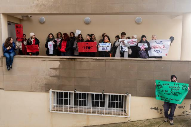 Activists protest outside the Famagusta District Court in support of the British teenager (AFP/Getty)
