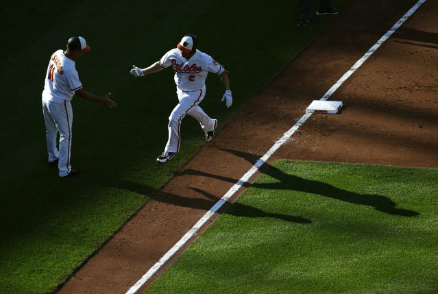 Baltimore Orioles' Danny Valencia, right, rounds the bases on a three-run home run past third base coach Bobby Dickerson in the sixth inning of the first baseball game of a doubleheader against the New York Yankees, Monday, July 9, 2018, in Baltimore. Baltimore won 5-4. (AP Photo/Patrick Semansky)
