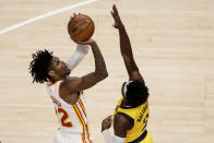 Atlanta Hawks guard Cam Reddish (22) shoots over Indiana Pacers guard Justin Holiday (8) during the fourth quarter of an NBA basketball game Saturday, Feb. 13, 2021, in Atlanta. (AP Photo/Butch Dill)