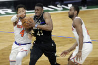 Milwaukee Bucks' Thanasis Antetokounmpo (43) drives to the basket against New York Knicks' Derrick Rose (4) during the second half of an NBA basketball game Saturday, March 27, 2021, in Milwaukee. (AP Photo/Aaron Gash)