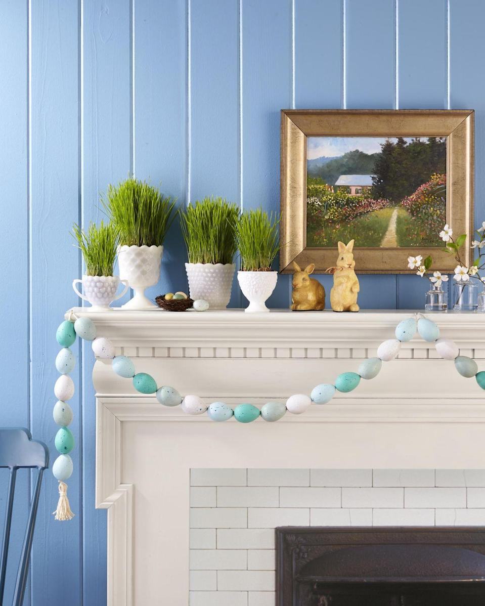 <p>Display this simple to make garland year after year.<strong><br></strong></p><p><strong>To make:</strong> Use an awl to poke holes in ends of papier-mâché eggs, then paint eggs white, robin's-egg blue, and turquoise with acrylic paint. Once dry, spatter with dark blue paint. Thread twine through holes, and hang, adding a tassel detail, if desired.</p>