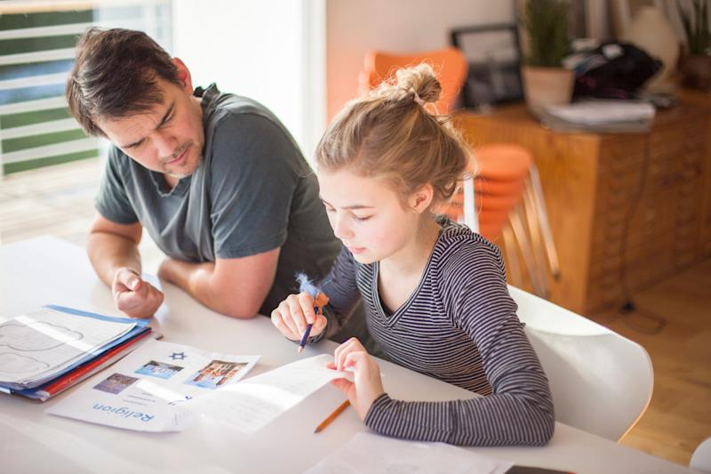 """""""We suggest parents think of themselves as consultants, rather than a kid's manager or boss, or the homework police."""" (Photo: Johner Images via Getty Images)"""