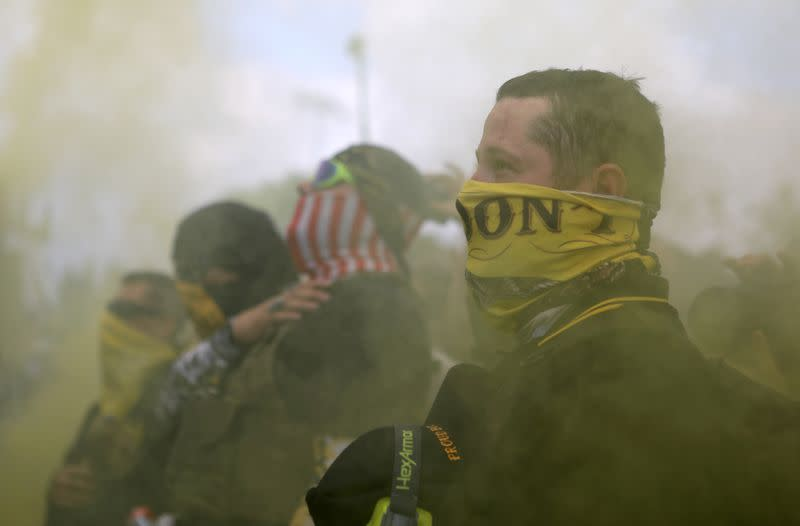 FILE PHOTO: Members of Proud Boys gather for a rally in Portland