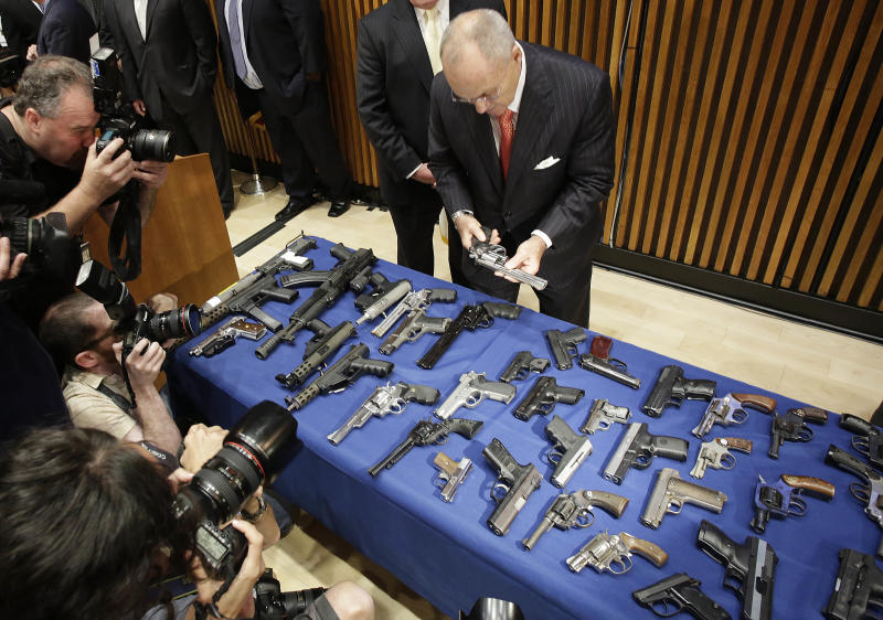 New York Police Commissioner Raymond Kelly looks at some of the guns seized as part of gun smuggling between the Carolinas and New York, Monday, Aug. 19, 2013 in New York. Authorities say couriers smuggled 254 guns into New York City by stashing weapons in their luggage on discount buses. The men were caught in a police sting that netted 254 weapons in 45 transactions since last year. (AP Photo/Mark Lennihan)