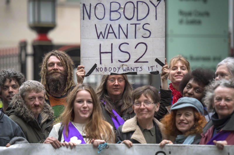 Protesters hold a banner outside the Rolls Building in central London, as Transport Secretary Chris Grayling launches High Court action in a bid to stop 'unlawful protest' by demonstrators opposed to the HS2 rail line running through a woodland area in west London.