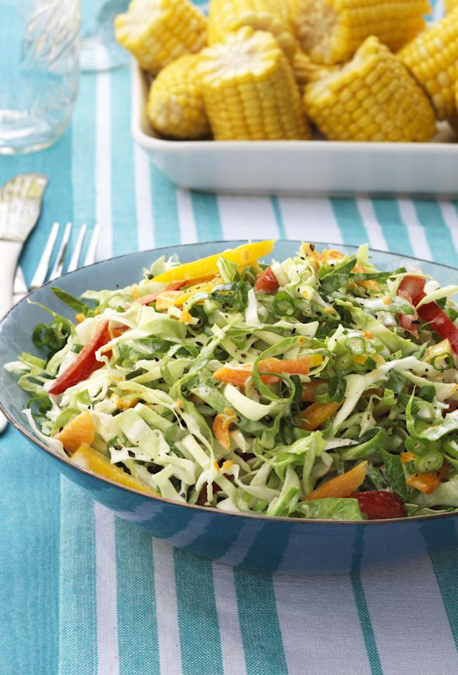 """<p>Keep your coleslaw light and refreshing by squeezing in some lime juice. </p><p><strong><a rel=""""nofollow"""" href=""""http://www.womansday.com/food-recipes/food-drinks/recipes/a12112/citrusy-slaw-peppers-scallions-recipe-wdy0713/"""">Get the recipe</a>. </strong></p>"""