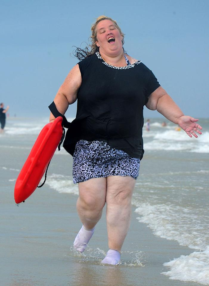 "EXCLUSIVE: **NO WEB until 1 pm PST June 12** Mama June Shannon runs on the beach with a lifeguard buoy in Tybee, GA. ""Honey Boo Boo"" and family hit up the Tybee Island Beach in Georgia for a mini vacation. June wore sock on the beach due to her mangled foot from a fork lift accident. They call it the fork lift foot and thats why June is wearing her socks on the beach.   Pictured: ""Mama"" June Shannon  Ref: SPL560575 120613  EXCLUSIVE  Picture by: Jason Winslow / Splash News     Splash News and Pictures  Los Angeles:	310-821-2666  New York:	212-619-2666  London:	870-934-2666  photodesk@splashnews.com"