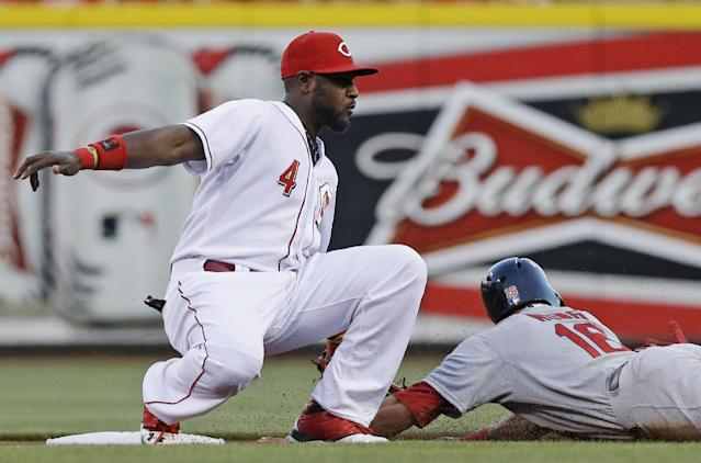 St. Louis Cardinals' Kolten Wong (16) steals second base as Cincinnati Reds second baseman Brandon Phillips (4) is late with the tag in the first inning of a baseball game, Sunday, May 25, 2014, in Cincinnati. (AP Photo/Al Behrman)