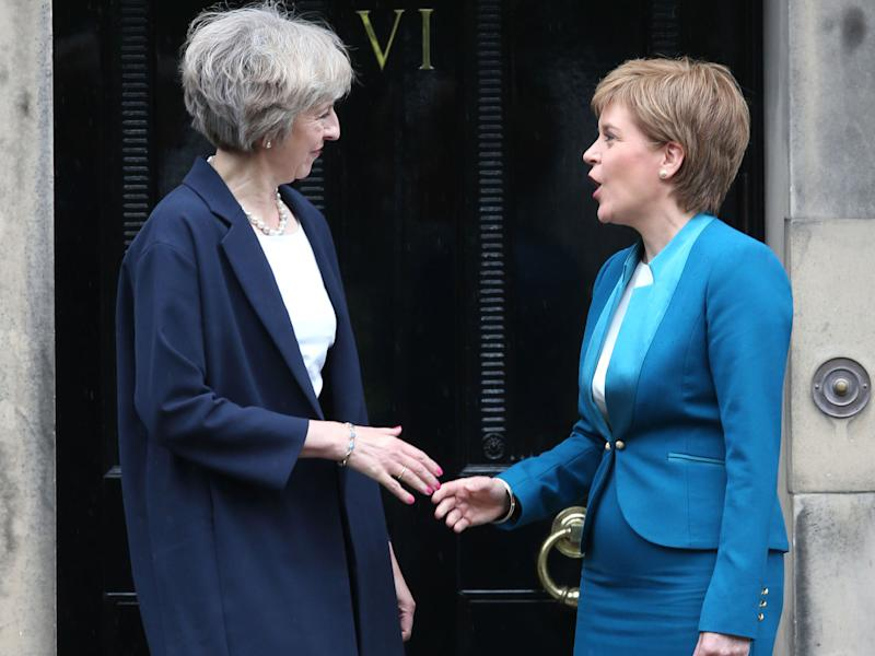 Theresa May and Nicola Sturgeon are clashing over Scotland's referendum date: PA