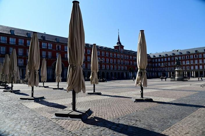 Public spaces such as the Plaza Mayor in central Madrid have already largely emptied (AFP Photo/JAVIER SORIANO)