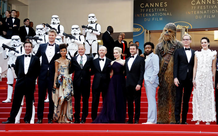 "71st Cannes Film Festival - Screening of the film ""Solo: A Star Wars Story"" out of competition - Red Carpet Arrivals - Cannes, France May 15, 2018. Producer Simon Emanuel and director Ron Howard pose with cast members Joonas Suotamo, Thandie Newton, Chewbacca character, Woody Harrelson, Emilia Clarke, Phoebe Waller-Bridge and Alden Ehrenreich. REUTERS/Eric Gaillard"