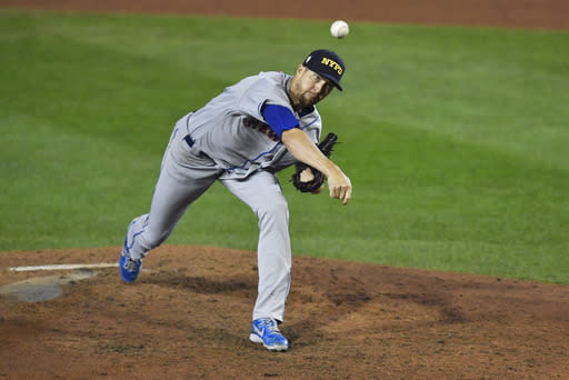 New York Mets starting pitcher Jacob deGrom throws to a Toronto Blue Jays batter during the sixth inning of a baseball game in Buffalo, N.Y., Friday, Sept. 11, 2020. (AP Photo/Adrian Kraus)