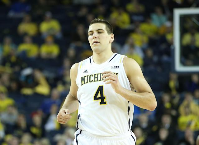 ANN ARBOR, MI - NOVEMBER 29: Mitch McGary #4 of the Michigan Wolverines runs down the court in his first home game of the season during the second half of the game against Coppin State Eagles at Crisler Center on November 29, 2013 in Ann Arbor, Michigan. Michigan Defeated Coppin State 87-45. (Photo by Leon Halip/Getty Images)