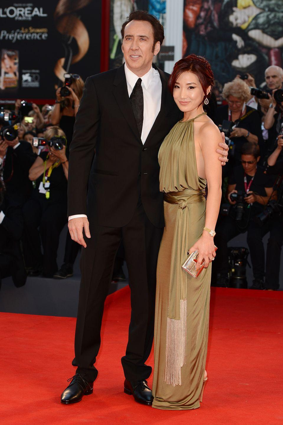 <p>Alice Kim was working as a waitress when she met Nicholas Cage at a restaurant in Los Angeles in 2004. The couple married within the year and were together for twelve years before divorcing in 2016. </p>