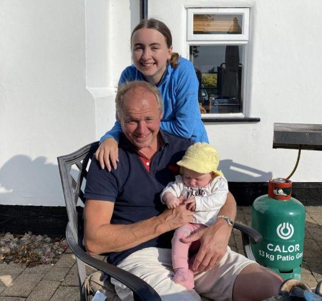 The author with her dad and her baby sister in her dad's garden in September 2020. (Photo: Courtesy of Laura Purkess)