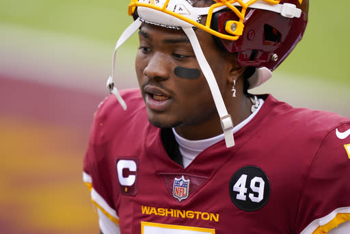 Washington Football Team quarterback Dwayne Haskins (7) before the start of an NFL football game against the Seattle Seahawks, Sunday, Dec. 20, 2020, in Landover, Md. (AP Photo/Susan Walsh)