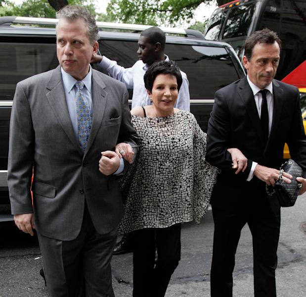"""Liza Minnelli arrives for the funeral of Marvin Hamlisch, in New York's Temple Emanu-El, Tuesday, Aug. 14, 2012. Hamlisch composed or arranged hundreds of scores for musicals and movies, including """"A Chorus Line"""" on Broadway and the films """"The Sting,"""" ''Sophie's Choice,"""" ''Ordinary People"""" and """"The Way We Were."""" He won three Oscars, four Emmys, four Grammys, a Tony, a Pulitzer and three Golden Globes. Hamlisch died Aug. 6 in Los Angeles at age 68. (AP Photo/Richard Drew)"""