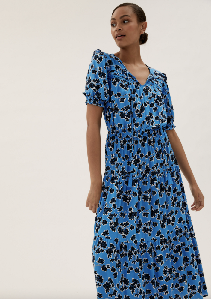 The Floral Tie Neck Midxi Waisted Dress boasts short puff sleeves, an elasticated waist and tie neck detail.  (Marks and Spencer)