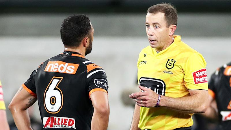 Match referee Ben Cummins talks with Benji Marshall of the Tigers.