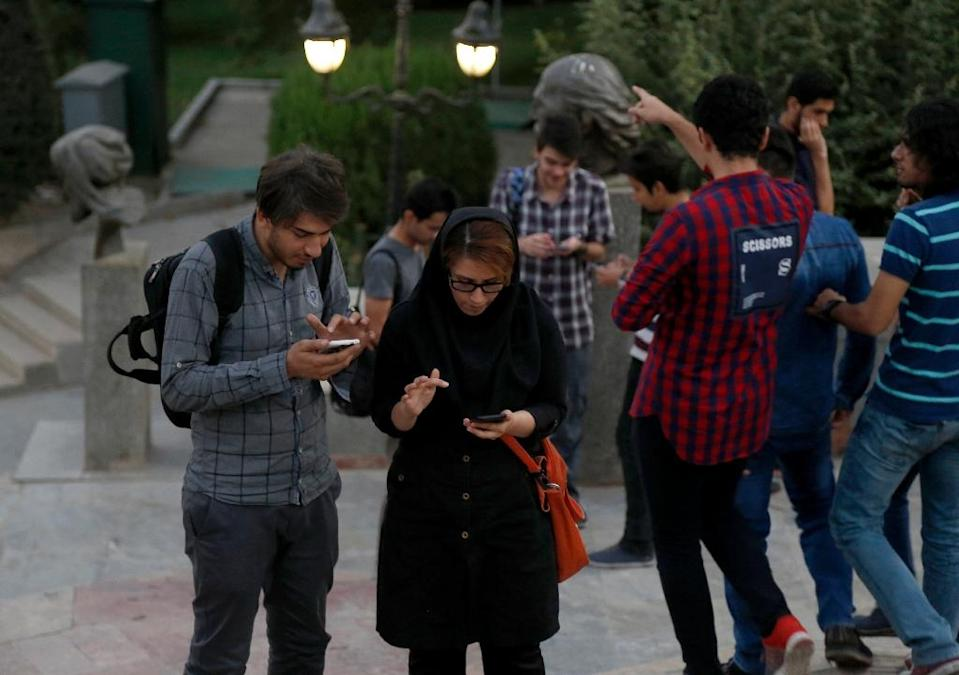 Iranians play Pokemon Go app in northern Tehran's Mellat Park on August 3, 2016 (AFP Photo/Atta Kenare)