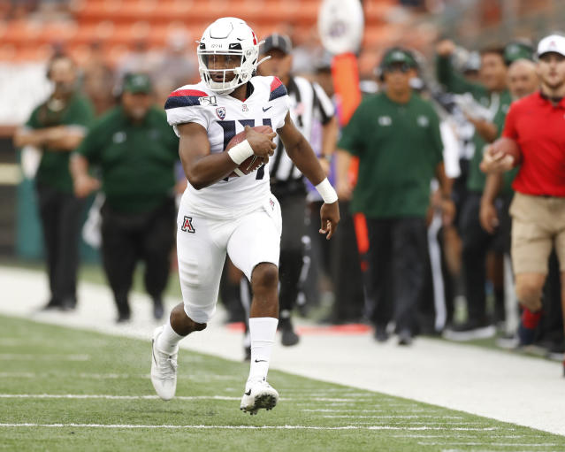 Arizona quarterback Khalil Tate (14) runs down the sideline during the second quarter during of the team's NCAA college football game against Hawaii on Saturday, Aug. 24, 2019, in Honolulu. (AP Photo/Marco Garcia)