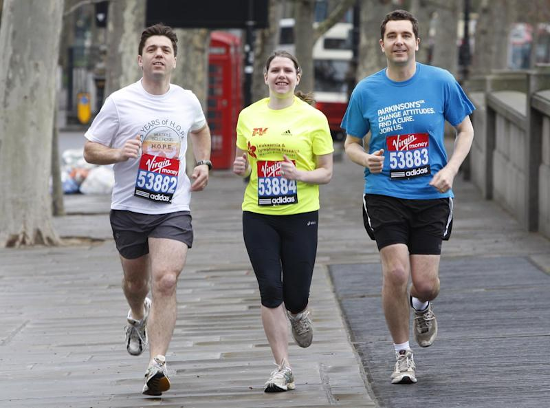 Three MPs (from left) Stephen Crabb MP for Pembrokeshire, Jo Swinson MP for East Dunbartonshire and Edward Timpson MP for Crewe and Nantwich take part in a training run outside the Houses of Parliament in central London as they prepare to take part in the 2011 London Marathon. (Photo by Sean Dempsey/PA Images via Getty Images)