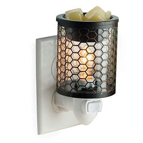 """<p><strong>CANDLE WARMERS ETC</strong></p><p>amazon.com</p><p><strong>$12.99</strong></p><p><a href=""""https://www.amazon.com/dp/B07KRM54K5?tag=syn-yahoo-20&ascsubtag=%5Bartid%7C2140.g.27102977%5Bsrc%7Cyahoo-us"""" rel=""""nofollow noopener"""" target=""""_blank"""" data-ylk=""""slk:Shop Now"""" class=""""link rapid-noclick-resp"""">Shop Now</a></p><p>Lighting a scented candle can soothe a new mama's (super tired) soul and transform her space in an instant. But if she's worried about lighting an open flame with a new baby in the house, this candle warmer is a good option for getting those cozy scents without fire. </p>"""