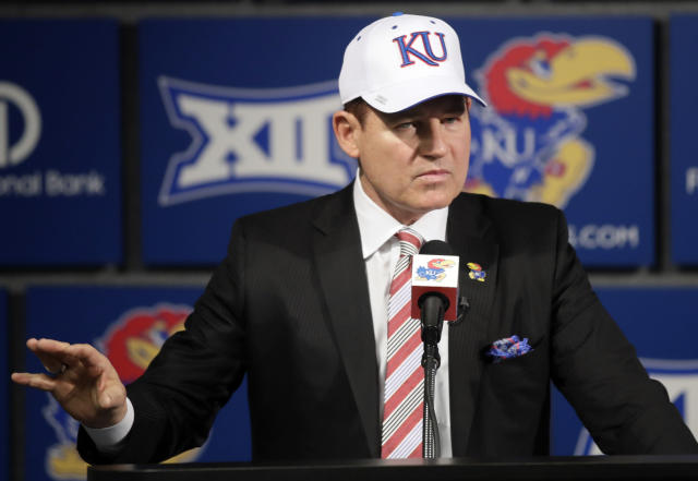 FILE - In this Nov. 18, 2018, file photo, University of Kansas new NCAA college football coach Les Miles makes a statement during a news conference in Lawrence, Kan. Miles is back in the Big 12, having been the head coach at Oklahoma State before he went to LSU and led the Tigers to the 2007 national title. Miles has been out of coaching since 2016, when he was fired by LSU after a 2-2 start that left him with a 114-34 record. When he got to Oklahoma State, the Cowboys had just one winning season in 12 years before Miles, that program then in similar shape to the Jayhawks now without a winning season or bowl game since 2008. (AP Photo/Orlin Wagner, File)