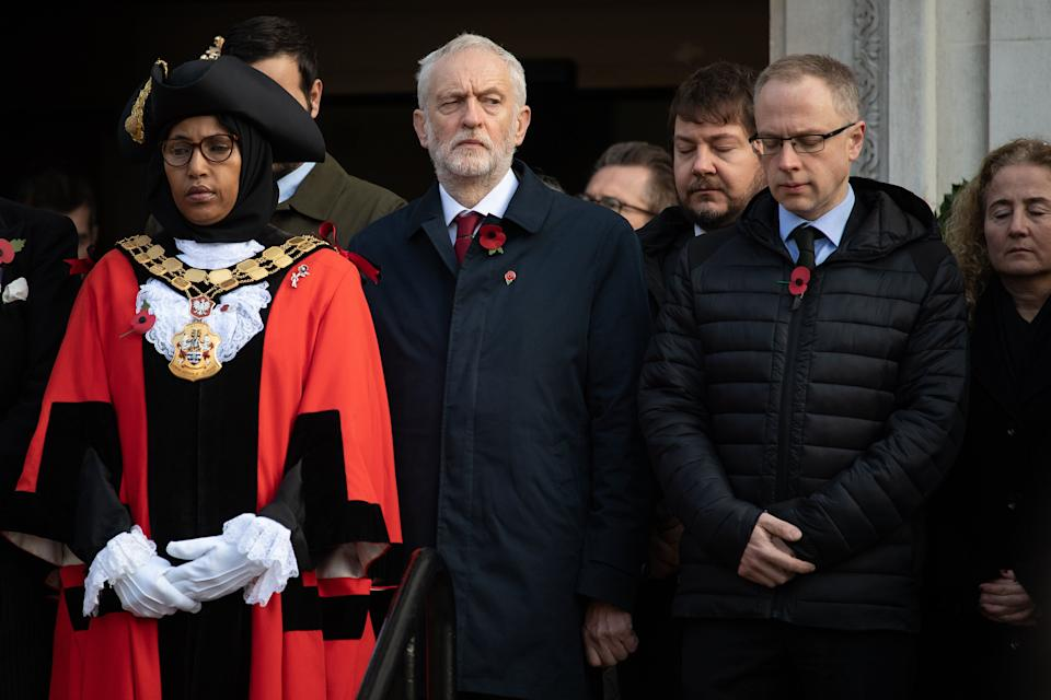 (Front, left to right) Rakhia Ismail with then-Labour leader and Islington North MP Jeremy Corbyn and Islington Council leader Richard Watts at the Armistice Day Commemoration at Islington Town Hall last year. (Photo: Leon Neal via Getty Images)