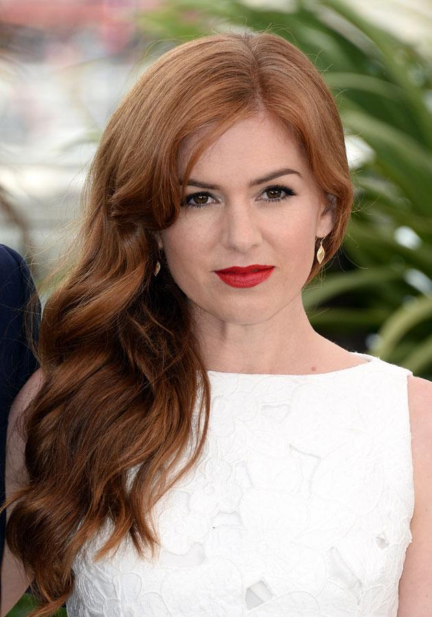 Celebrities wearing red lipstick: Isla Fisher dazzled in Cannes.<br><br>[Rex]