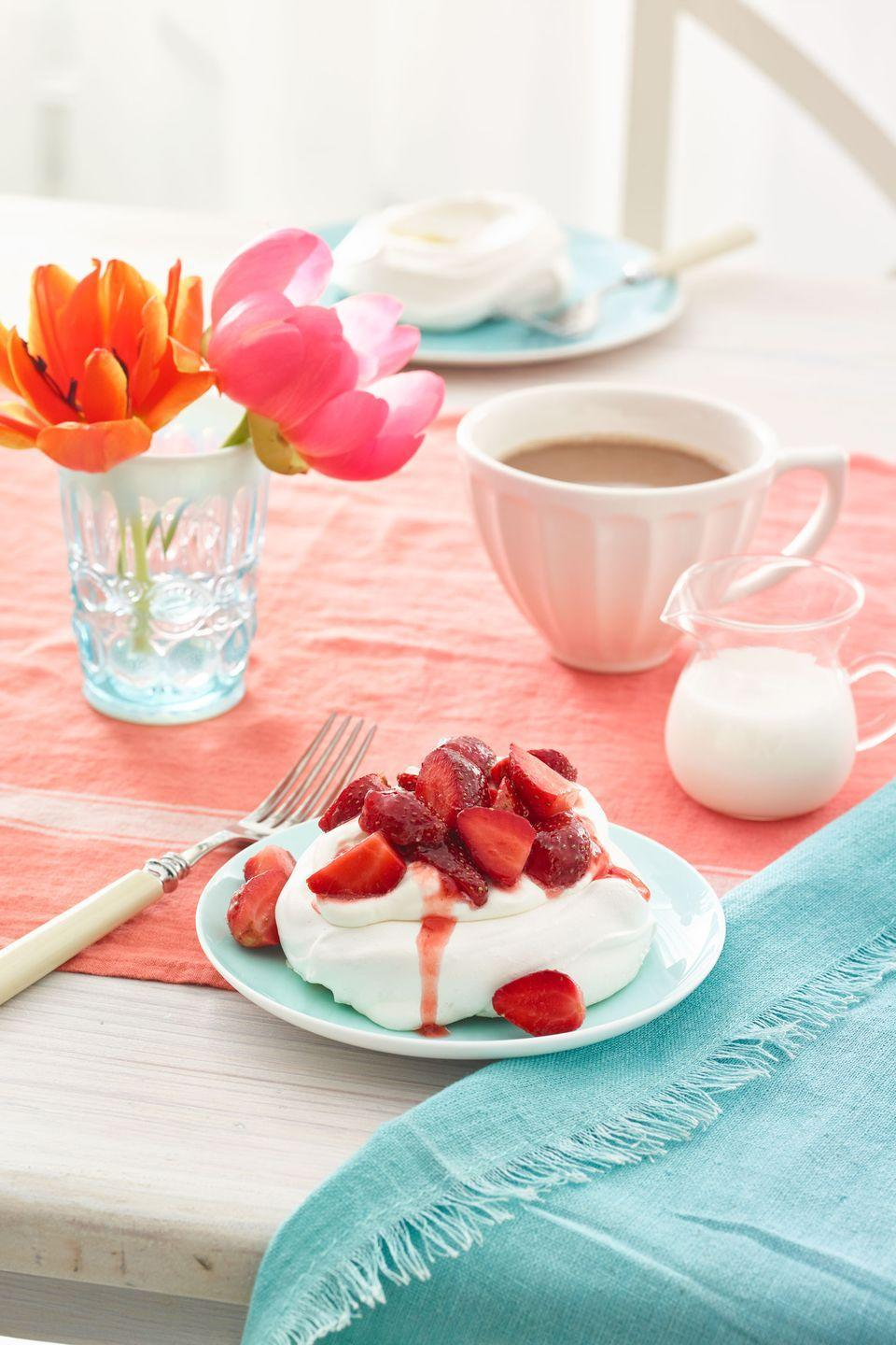 """<p>These elegant meringue swirls, topped with fresh strawberries, are almost too pretty to eat.</p><p><a href=""""https://www.womansday.com/food-recipes/food-drinks/recipes/a54431/pavlovas-with-strawberries-and-cream-recipe/"""" rel=""""nofollow noopener"""" target=""""_blank"""" data-ylk=""""slk:Get the recipe for Pavlovas with Strawberries and Cream."""" class=""""link rapid-noclick-resp""""><em>Get the recipe for Pavlovas with Strawberries and Cream.</em></a></p>"""