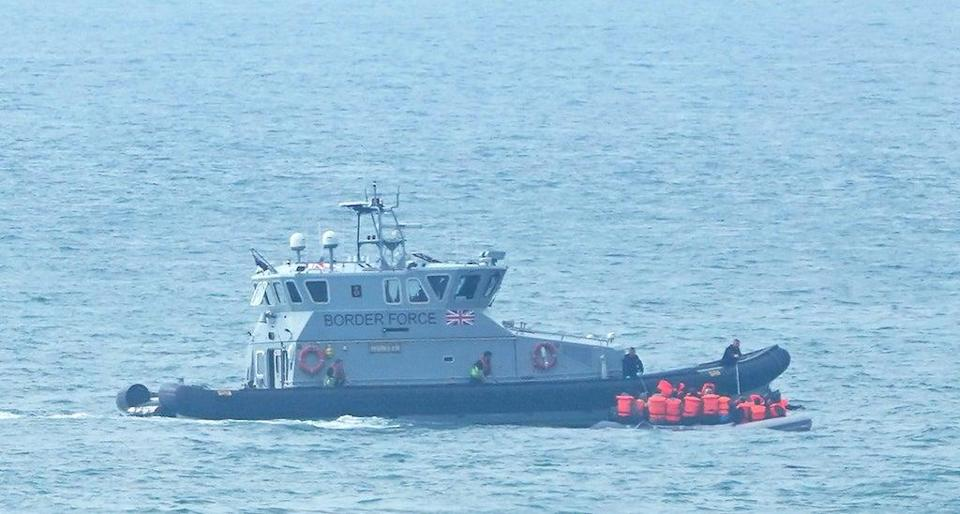 A Border Force vessel intercepts a group of people thought to be migrants in a small boat off the coast of Kent (Gareth Fuller/PA) (PA Wire)