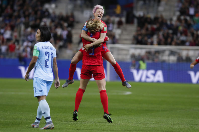Samantha Mewis # 3 of USA celebrates her goal with Megan Rapinoe # 15 during the Americans' win over Thailand at the World Cup. (Getty)