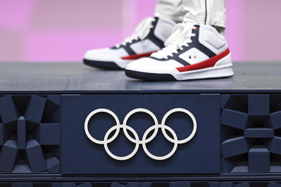 02 August 2021, Japan, Tokio: Shooting: Olympics, preliminary competition, Ol. rapid fire pistol 25 m, men, final, award ceremony, Asaka Shooting Range. The shoes of gold medallist Jean Quiquampoix from France. Photo by: Swen Pf'rtner/picture-alliance/dpa/AP Images - Credit: Swen Pf'rtner/picture-alliance/dpa/AP Images