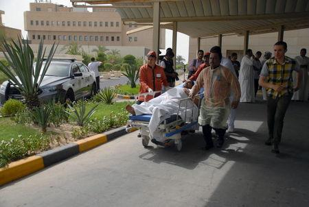 A victim of a suicide bomb attack at Imam al-Sadeq Mosque arrives at the Amiri hospital in Al Sharq, Kuwait City, June 26, 2015. REUTERS/Stringer
