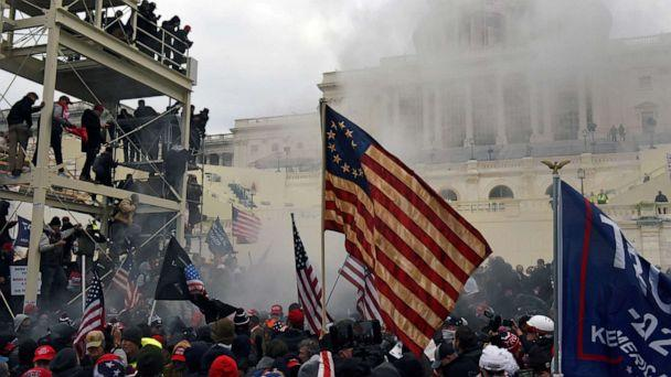 PHOTO: Supporters of President Donald Trump carry the Betsy Ross flag during the siege of  the U.S. Capitol Building in Washington, D.C., Jan. 6, 2021. (Stephanie Keith/Reuters)